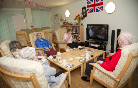 Residents at Miranda House attending their regular film club in the communal lounge at Miranda House  21 Penzance Place London W11 4PD